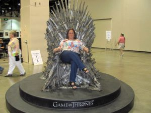 "Queen Jane, posing for posterity in the popular ""Game of Thrones"" prop chair, at Renovation, the 69th World SF Convention, Reno, NV 2011"