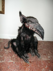 "One of our dogs, ""Spot"". He is one of Jeff Coleman's creations, part alligator, part Rottie, and suffers from mange. He is also perpetually hungry, because he only will eat tender young virgins, and they are rare in these parts."