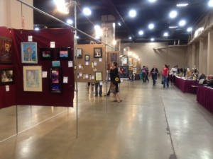 """3-D art tables are typically set off to the side or behind the """"main"""" art show panels for 2-D art, as here at the 71st Worldcon,  LoneStarCon3"""