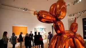 """Jeff Koons """"Balloon Dog (Orange) sculpture."""