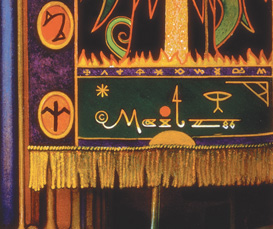 """""""Maitz"""" signature, part of the embroidery on the decorative banner"""