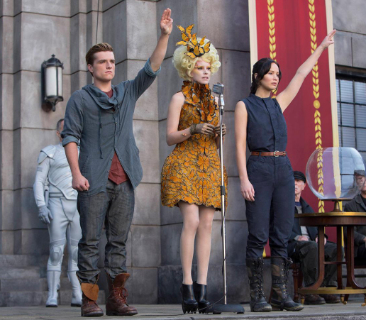 Figure 5 - from left, Peeta, Effie Trinket and Katniss at The Quarter Quell Reaping
