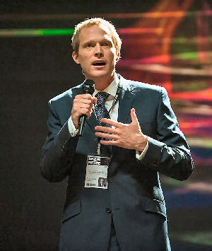 Figure 4 - Max (Paul Bettany) at fundraiser