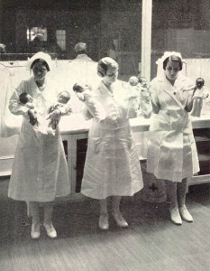 Nurses from an exhibition at Coney Island hold up the premature infants in their care. Courtesy of neonatology.org.