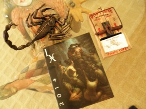 "Things I brought home for me: an adorable scorpion in bronze by Villafranca, a ""Must have"" 'mousetrap"" business card holder by Rich Klink, and the IX7 souvenir program book....I managed to resist the tee shirt, but now I wish I hadn't . . ."
