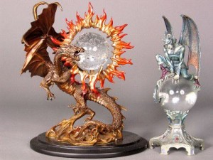 "Two by the Franklin Mint ""Dragon of Triumph"" by Jule Bell (left) and Guardian of Destiny"" by Gary Persello (right)"