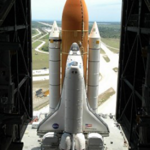 Space Shuttle First Flights: Ten Pounds in a Five Pound Sack