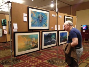 Long-time Collector and scholar Alex Eisenstein gazes intently at the work of Edward Miller at the WFC 2014