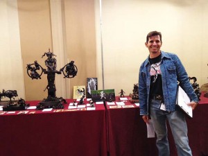 Sculptor Vincent Villafranca, in front of his display of works in bronze,  WFC 2014