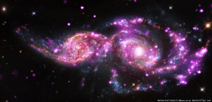 NGC 2207 and IC 2163 are two spiral galaxies in the process of merging.