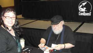 Roslynn Ernst having her Game of Thrones book signed by George R. R. Martin at the Conquest 46.  picture taken by Jason Ernst