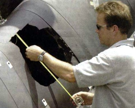 16-inch hole in Shuttle wing panel after fuel-tank foam insulation impact test