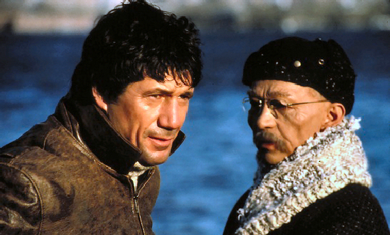 Figure 6 - Fred Ward and Joel Grey in REMO, THE ADVENTURE BEGINS