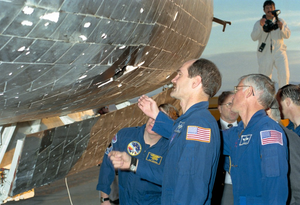 Crew of STS-27 Examine Tile Damage on Atlantis