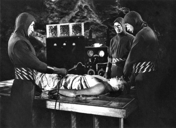 Figure 6 - Operating table with Martin (Graves) and Bug-Eyed Aliens CENTER