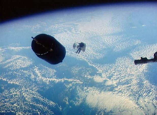Dale Gardner approaches Westar satellite STS-51A