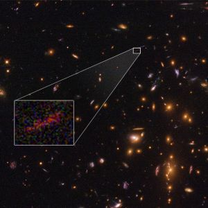 NASA's Great Observatories Team Up to Find Magnified and Stretched Image of Distant Galaxy