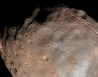 Scientists May Have Solved Mystery of How Martian Moon Got Markings