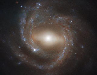 Hubble Captures Our Galactic Twin, the Barred Spiral Galaxy NGC 7773 | Digital Trends