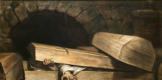 A nun reaches from inside her coffin